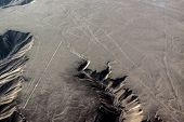 pic of geoglyph  - Humming Bird and Trapezoids. The Nazca Lines are a series of geoglyphs located in the Nazca Desert. Peru.