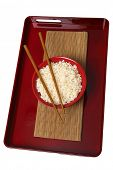 Red tray with red bowl of rice and wooden chopsticks on white