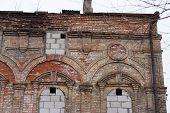 image of corbel  - Wall of an old deserted brick building with architectural details - JPG