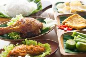 Popular delicious Indonesian local food nasi ayam penyet, indonesian fried chicken rice with sambal
