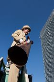 Performer Calls People Using A Vintage Loudhailer At Milan Clown Festival 2014