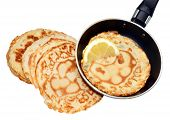 pic of tuesday  - Freshly made pancakes with lemon and frying pan - JPG