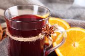 Mulled wine with oranges fabric background