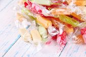Tasty candies on wooden background