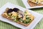 Scrambled Eggs With Mushrooms And Peas On Grain Bread