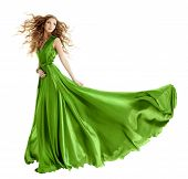 stock photo of hair blowing  - Woman in beauty fashion green gown long evening dress over isolated white background - JPG