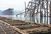 Wooden Bridge In Misty Morning