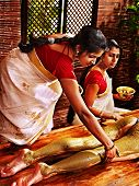 Young woman having feet Ayurveda spa massage.