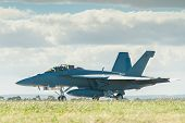 stock photo of f18  - F18 Hornet at airport on runway taxiing - JPG