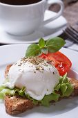 stock photo of benediction  - sandwich with egg Benedict and tomato on plate and coffee - JPG