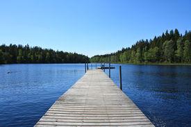 stock photo of dock a lake  - Beautiful Lake in the south of Sweden near Torsas - JPG