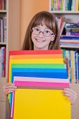 Schoolgirl  holding colored papers