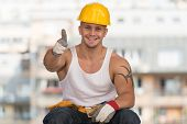Smiling Contractor Showing Thumb Up