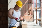 Construction Man Hitting Wood With Hammer