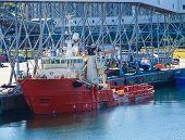 Orange Working Ship At Industrial Port