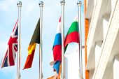 Four Flags On Flagpoles Countries