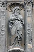 PARIS, FRANCE - NOV 11, 2012: Statue at the south portal of the church of St. Eustache in Paris, Fra