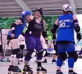 Jammer And Defender Enjoy A Light Moment Roller Derby Match