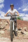 Handicapped Mountain Bike Rider Between Rocks