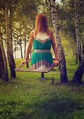 stock photo of levitation  - Scary woman getting out from an old frame in the forest while levitating - JPG