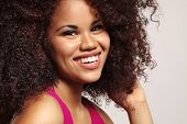 foto of afro hair  - smiling woman with a huge afro hair - JPG