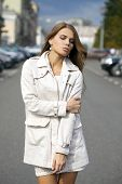 young woman  in white coat
