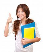 Portrait of happy teen girl well passed exam, cheerful teenager with books gesturing thumbs up isolated on white background, back to school concept