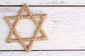 Star of David on wooden background