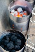 stock photo of barbie  - Charcoals in metal container prepared for barbecue grill - JPG