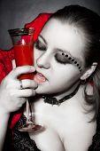 Vampire in red top-collar dress