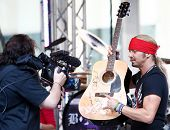 NEW YORK-JUL 18: Recording artist Bret Michaels autographs a guitar to be donated at the Hard Rock C