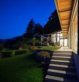 Night landscape with alight villa, steps and veranda