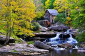 picture of water-mill  - A picture of a grist mill with a flowing water fall below - JPG