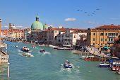 VENICE, ITALY - SEPTEMBER 9, 2010: Elegant, carefree tourists on the vaporetto and gondola on Grand