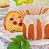 Sliced Lemon And Caraway Seed Bundt Cake With Raspberries