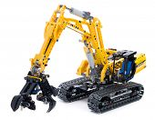 Ankara, Turkey - October 27, 2013:  Lego technic excavator isolated on white background.