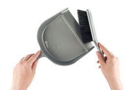 image of sweeper  - Hands with dustpan and brush floor sweeper over white background - JPG