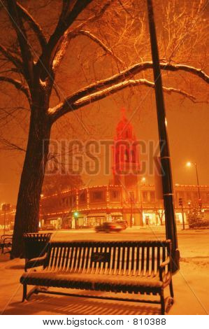 poster of snowfall on the plaza, Kansas City, Mo. with the plaza lights, and bench