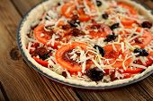 Unbacked Tomato Tart With Olives Selective Focus On Wooden Background