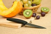 Mix of fruits with cutting board and knife