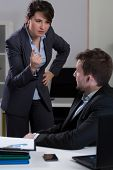 pic of deprivation  - Vertical view of chief bullying his assistant