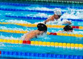 Breaststroke Girls Swimmers In Swimming Race