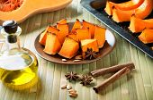Baked Pumpkin, Cinnamon Sticks, Star Anise And Olive Oil On A Kitchen Table Horizontal Top View