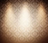 light brown wallpaper with three spots.