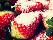 Close up on fresh red strawberries with sugar.