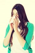 Young beautiful woman with tissue and runny nose