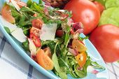 stock photo of chicory  - Plate of fresh tomato rocket chicory and sheep - JPG