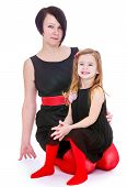 Charming mother and daughter bright red black suits.