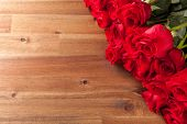 Bouquet of roses on wooden desk