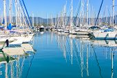 pic of sloop  - Panorama of a big Gouvia harbour with white yachts and boats on a beautiful sunny day over the island of Corfu - JPG